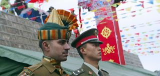 Members of the Chinese and Indian armed forces attend a ceremony marking the opening of the border between India's Sikkim state and Tibet at Nathu La pass in the Himalayas.