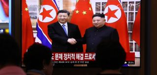 Chinese President Xi Jinping and North Korean leader Kim Jong Un are shown on a railway television monitor in Seoul, South Korea, on June 20, 2019.