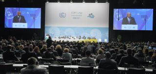 Fijian Prime Minister Frank Bainimarama delivers a speech at the opening of the 23rd Conference of the Parties to the U.N. Framework on Climate Change, which Fiji presided over in Bonn, Germany, on Nov. 6-17.