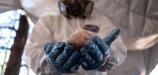 A Mexican Army expert in protective gear displays crystal meth paste at a clandestine laboratory near la Rumorosa town in Tecate, Baja California state, Mexico on Aug. 28.