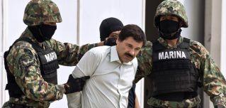 """Mexican drug trafficker Joaquin Guzman Loera, aka """"el Chapo Guzman"""" (C), is presented to the press on Feb. 22, 2014 in Mexico City."""