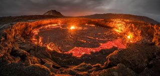 """Lava rises to the top inside Erta Ale volcano in the Afar region of northeastern Ethiopia. The Ethiopian volcano is home to the world's oldest continuously active lava lake, known as the """"Gateway To Hell."""""""