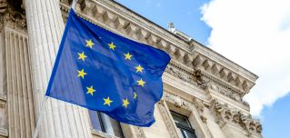 The EU flag flies over the stock exchange building in Brussels.