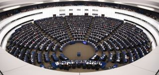 Members of the European Parliament vote during a plenary session at the European Parliament on Dec. 11, 2018, in Strasbourg.
