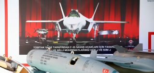 A picture showing Turkish weapons designed for the U.S.-built F-35 fighter jet are displayed in Ankara, Turkey, on Oct. 31, 2018.