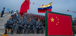 Venezuelan soldiers sit next to their Chinese counterparts during the opening ceremonies for the portion of the International Army Games held in China's Hubei province.
