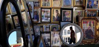 Portraits of Iraqi Kurdish leader Massoud Barzani hang in a store in the northern Iraqi city of Arbil. Iraqi Kurds hold an independence referendum on Sept. 25.