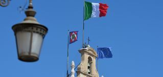 The Italian and EU flags fly over the Quirinale Palace in Rome.