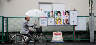A man walks past electoral posters of Japanese candidates for the upcoming Oct. 22 general elections in Koshigaya city, Saitama prefecture, on Oct. 20, 2017. The final official results of the elections will be announced early Oct. 23.