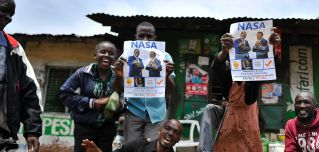Supporters of Kenyan opposition National Super Alliance (NASA) leader Raila Odinga celebrate in the streets of the Mathare slum in Nairobi on Sept. 1.
