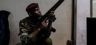 A Kenyan security officer secures a building attached to the Dusit D2 compound in Nairobi after a prolonged gun battle rocked the upmarket hotel complex, Jan. 15.