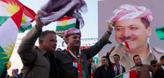 Iraqi Kurds gather in the streets of Arbil to urge people to vote in the upcoming independence referendum.