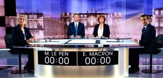 French presidential election candidate Marine Le Pen (L) faces off against Emmanuel Macron. Voters go to the polls on Sunday to determine who will hold one of the most powerful democratically elected positions in the world.