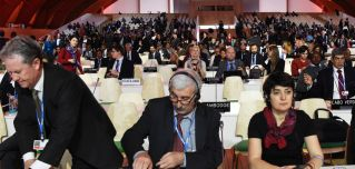 Delegates attend a plenary session at the U.N. climate change summit in Paris on Dec. 9.