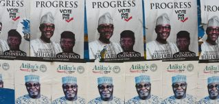 Side-by-side campaign posters line a bus stop for President Muhammad Buhari and his challenger, Atiku Abubakar, ahead of the presidential election on Feb. 16.