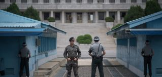 South Korean soldiers stand on duty at the Demilitarized Zone along the 38th parallel, the line distinguishing North Korea from South Korea.
