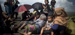 Rohingya refugees rest after crossing from Myanmar into Bangladesh in September.