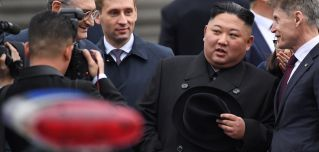 North Korean leader Kim Jong Un (2R) listens to Primorsky Gov. Oleg Kozhemyako (R) upon arrival at the railway station in Vladivostok on April 24, 2019.