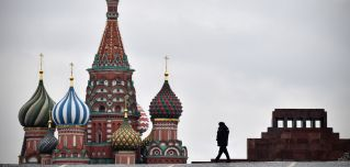 A Russian policeman walks in Red Square in Moscow on Nov. 5, 2017, with the Lenin Mausoleum and St. Basil's Cathedral in the background.