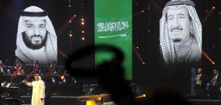 A portrait shows King Salman bin Abdul-Aziz Al Saud Salman (R) and Crown Prince Mohammed bin Salman.
