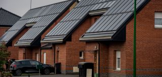 Solar panels power a pair of brick houses in Loos-en-Gohelle, France.
