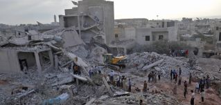 Syrians gather in Zardana (Idlib province) after airstrikes, believed to have been launched by Russia, killed about 40 civilians in early June.