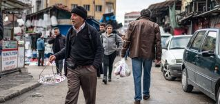 This photo shows a tea seller plying his wares in a shopping district of Ankara, Turkey.