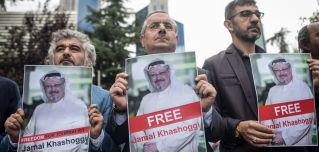 People hold posters of Saudi journalist Jamal Khashoggi during a protest organized by members of the Turkish-Arabic Media Association at the entrance to Saudi Arabia's consulate on Oct. 8 in Istanbul.