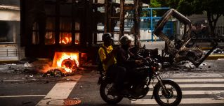 The question for multinational companies active in Venezuela is how to handle the country's current crisis.