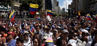Supporters of Venezuelan opposition leader Juan Guaido take part in a rally to let in U.S. humanitarian aid, in Caracas on Feb. 12, 2019.