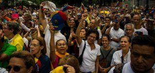 Numerous people wearing caps in the colors of the Venezuelan flag take part in a protest against the government of President Nicolas Maduro on Venezuela's day of independence.