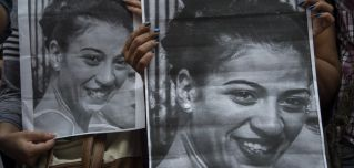 Protesters hold pictures of Valeria Sosa, a 29-year-old dancer killed by her former partner, as they march to condemn violence against women in Montevideo, Uruguay, on Feb. 2, 2017.