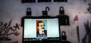 "A laptop screen in Istanbul shows an image of Turkish President Recep Tayyip Erdogan emblazoned with the slogan ""Yes We Ban,"" a play on former U.S. President Barack Obama's campaign iconography."