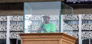 Ethiopian Prime Minister Abiy Ahmed addresses a rally behind protective glass in Addis Ababa on June 23.