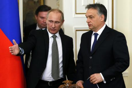 Russia's President Vladimir Putin (L) and Hungary's Prime Minister Viktor Orban (R) speak during a meeting at Putin's residence outside Moscow, on January 14, 2014.