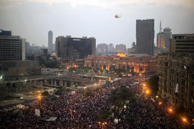 Egypt: An Egyptian army helicopter flies over protesters calling for the ouster of President Mohamed Morsi in Cairo's Tahrir Square on July 3. (GIANLUIGI GUERCIA/AFP/Getty Images)