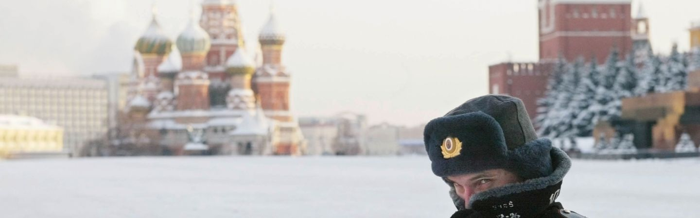 8838acb3b85 A Russian police officer patrols Red Square in the bitter cold of Russian  winter.