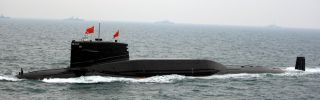 Chinese Navy submarine participates in an international fleet review to celebrate the 60th anniversary of the founding of the People's Liberation Army Navy.