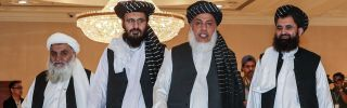 Mohammad Nabi Omari (C-L), a Taliban member formerly held by the United States at Guantanamo Bay, Taliban negotiator Abbas Stanikzai (C-R) and former Taliban intelligence deputy Mawlawi Abdul Haq Wasiq (R) walk with another Taliban member during the second day of the Intra-Afghan Dialogue talks in Doha on July 8, 2019.