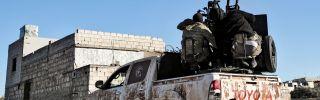 Turkish-backed Syrian fighters man an anti-aircraft gun in Saraqeb, in the northwestern Syrian province of Idlib on Feb. 1, 2020.
