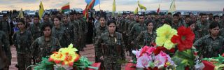 Members of the Women's Protection Units (YPJ) take part in the funeral of eight fighters on Nov. 8, 2015, in Derik, Syria.