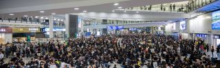 Pro-democracy protesters fill the arrivals terminal of Hong Kong International Airport on July 26, 2019.
