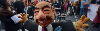 A puppet showing former Italian Prime Minister Silvio Berlusconi is displayed at the start of the No Monti Day demonstration on October 27, 2012 in Rome.