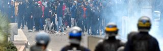 Protesters face riot police on Dec. 7, 2018, in Toulouse, France.