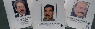 "A deck of the ""52 most-wanted Iraqi"" playing cards from Operation Iraqi Freedom on display in October 2014 at the Pentagon showing high-level members of the Baath Party."