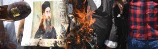 Protesters burn a picture of Islamic State leader Abu Bakr al-Baghdadi on June 9, 2017, in New Delhi.