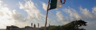 A Mexican flag at a beach Sept. 18, 2019, in Cancun, Mexico.