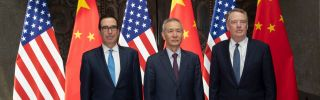 U.S. Treasury Secretary Steven Mnuchin (left) and U.S. Trade Representative Robert Lighthizer flank Chinese Vice Premier Liu He as they pose for photographs before holding trade talks in Shanghai on July 31, 2019.