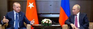 Turkish President Recep Tayyip Erdogan, left, meets with Russian President Vladimir Putin on Sept. 17, 2018, in Sochi, Russia.