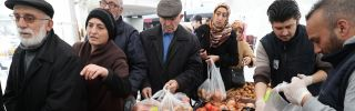 People line up to buy subsidized vegetables at a tent set up by the Ankara Metropolitan Municipality in the Cankaya district of the Turkish capital on Feb. 13, 2019.